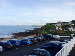 The hotel car park, perched on the cliff above the cove